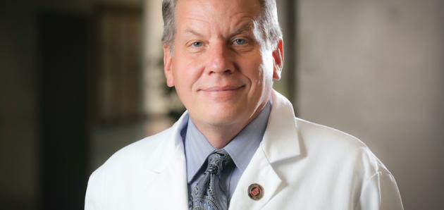 Headshot of Doctor Atkinson